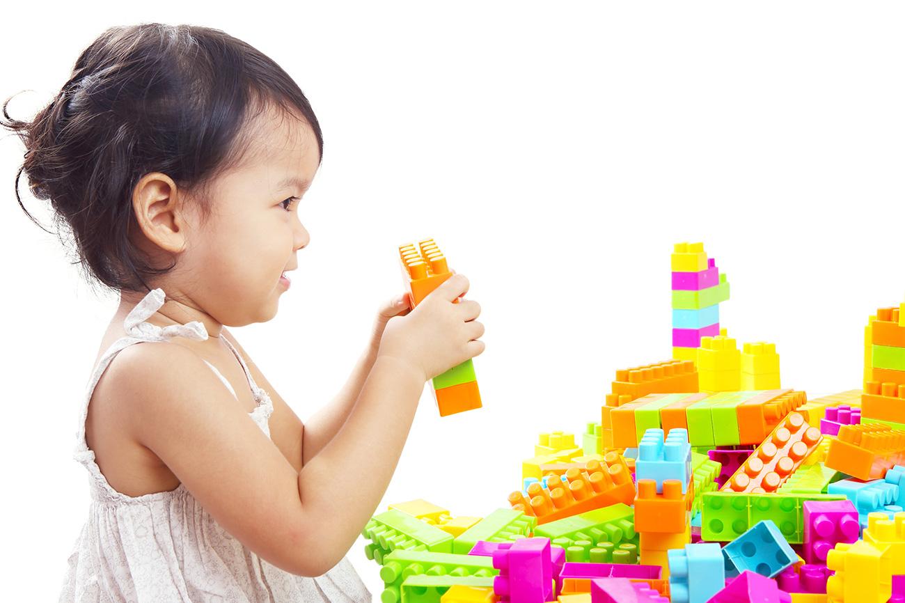 Girl playing with blocks at Priceton School - Phnom Penh - Cambodia